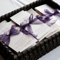 purple programs Tri fold with ribbon