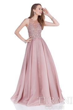 Organza+prom+gown+with+nude+illusion+bodice+that+is+intricately+adorned++with+a+cascade+of+crystals.+This+prom+dress+is+finished+with+a+full+ball++skirt.