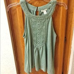 Francesca's Boutique Halter Tank Selling this high neck halter tank from Francesca's Boutique. This tank is a light green color. Only been worn once before. Francesca's Collections Tops