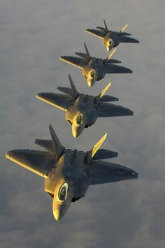 F-22 Raptors in formation, a frgn beautiful site, 2 bad such a super limited production number due to close to 20 mil $ price tag APIECE!!!!!