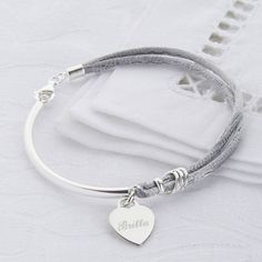 Gorgeous silk and sterling silver bracelet with a personalised silver heart or disc in a choice of colours.We are also able to engrave symbols such as hearts, crosses, stars etc. For symbols such as heart (show as <3) and kisses (X) Please contact us via 'Ask the seller a question' if you would like help with your engraving requirements, we are happy to advise you. Personalisation is carried out in our workshop by our master engravers and usually dispatched the same day. All our jewellery…
