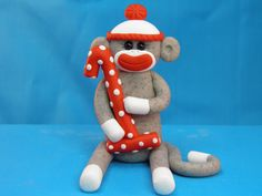 Ridiculously cute sock monkey cake topper perfect for sock monkey birthday party!