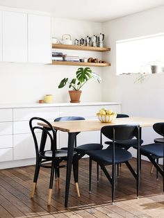 beautiful mix of black dining chairs / the design files