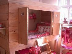 Okay, now this would be cool for the girl-twin's room. She has very limited floor space, so why not build her bed UP? Having it be a cabinet style would be so cozy, and let her allow her imagination to play. So cool!