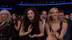 Lorde clapping after Taylor Swift performs at the AMAs