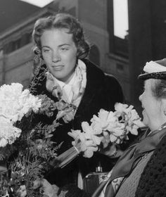 Julie Andrews buying flowers in Covent Garden during the original run of My Fair Lady in April 1958