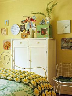 A scavenged metal dresser and chair join with the bed frame to bring an industrial edge to the bedroom. The rusty potato chip rack is an ever-changing display of photos, postcards, and other small mementos.