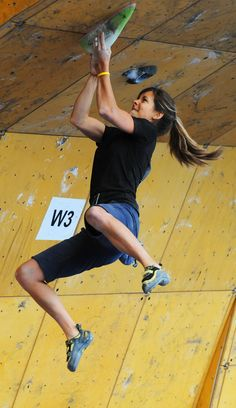 ∆-e79a05cc-825q36w - athletic woman - indoor rock climbing - Andrea Szekely pulls herself up while competing in the World Cup Bouldering competition at the Teva Mountain Games in Vail, Colorado.