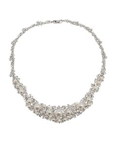 "Our best selling necklace features a dazzling array of crystal accents and glass pearls. Available in white and champagne pearl colors. - 16"" length - Snap clasp - Lead and nickel safe"