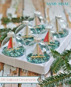 DIY Sailboat Ornaments. #coastal http://www.aftershocksinteriordecorating.com/interior-decorating-and-design-blog