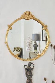 An Impressive Baroque Style Very Decorative Ornate Oval Wall Mirror Designed To Hang In The Portrait Orientation And Finished Here Antique G