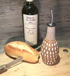 Ceramic Olive Oil bottle-  Carved bottle with a toasted cream glaze with food grade spout  -  Ready to Ship by bridgespottery on Etsy