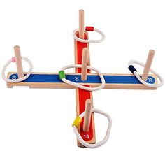 Sugoiti Ring Toss Game Set - Wooden Quoits for Kids Adults Indoor or Outdoor Games with Rope Rings. Our ring toss game is well-constructed and helps improve Hand-eye coordination, color sorting, accuracy and gross movements. Ring toss is an ancient, fun, healthy and social game that can be played indoors or outdoors. It can be played on sand or on grass. Kids games can help positively channel a child's physical and mental energies: game play can also help a child improve concentration…