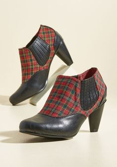 Scholastic Tactic Bootie. This semester, your academic advancements are happening in leaps and bounds thanks to these plaid heels from Banned! #black #modcloth