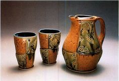 This pitcher and tumblers are wheel-thrown stoneware with stamped decoration and were created by Jennifer Everett of Gorham, Maine. Everett was a 2004 Emerging Artist.