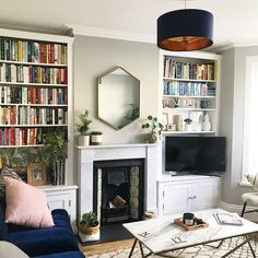 Focal Point I lusted after this west elm UK mirror for mon… - Home Professional Decoration Bookshelves In Living Room, Living Room With Fireplace, New Living Room, Interior Design Living Room, Living Room Designs, Living Room Decor, Alcove Bookshelves, Mirror Over Fireplace, Alcove Cupboards