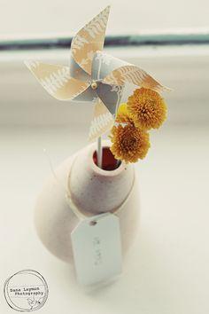 Pinwheel + simple flower = easy decor available in any color. Yellow Grey Weddings, Orange Wedding, Gray Weddings, Wedding Grey, Wedding Flowers, Dream Wedding, Wedding Dreams, Wedding Stuff, Pinwheel Centerpiece