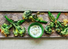 Crispy beer-battered broccoli tempura dipped into yogurt sauce is a healthy, delicious appetizer or side.