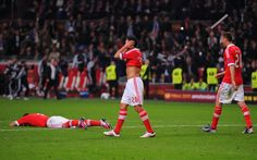 Amsterdam, 2013 - A dejected Nicolas Gaitan of Benfica holds head after defeat during the UEFA Europa League Final between SL Benfica and Chelsea FC at Amsterdam Arena on May 15, 2013 in Amsterdam, Netherlands.