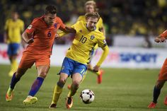 Kevin Strootman of Netherlands and Emil Forsberg of Sweden competes for the ball…