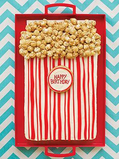 Fresh-Popped Birthday Cake: Pull 'n' Peel Twizzlers, white frosting, and caramel corn turn an ordinary cake in to a cool confection for a circus- or movie-themed birthday party!