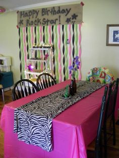 Girls Rock Star party. We dressed up the table to pick table cloth and a zebra curtain as a table runner. Root beer bottles with flowers from garden pink star and chocolate guitars as a center piece.