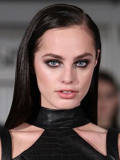 """The look: Meet the modern smoky eye. Revlon Global Artistic Director, Gucci Westman created a """"sporty and edgy eye"""" by mixing different textured shadows. Hair was straight with slick-shine. The products: Eyes: ColorStay Shadowlinks in Onyx and Khaki £2.99 (in store March 2014), ColorStay 16HR Shadow in Exotic £7.99 (Gucci Westman Spring/Summer '14 Collection, in store March 2014), ColorStay Skinny Liquid Liner in Black Out £7.99 (in store July 2014), Bold Lacquer by Grow Luscious in ..."""
