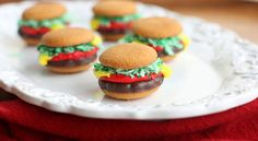 """Mini """"Burger"""" Cookies made from vanilla wafers, grasshopper fudge cookies, coconut, and frosting as the condiments. I remember these from Girl Scout camp! Fudge Cookies, Wafer Cookies, Pinata Cookies, Pinwheel Cookies, Mini Cookies, Sweet Cookies, Cookie Icing, Chip Cookies, Cookie Dough"""