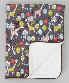 The perfect travel blankie doesn't just provide softness for snuggles, it's also darling, durable and compact enough to come along on little ones' adventures near and far. This blanket is fit for such important duties, with a playful cotton print on one side and super-plush, sensory-pleasing minky on the other. A sturdy top stitch ensures it will be around for years of cuddles and washes to come.