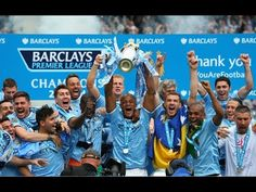 Manchester City lift the Premier League trophy after being crowned champ...