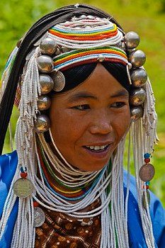 Women of the Akha tribe wear elaborate headdresses made of beads, silver coins and hand loomed cotton - village near Kengtung or Kyaingtong - Myanmar, Burma ...