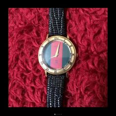 Authentic Vintage Gucci Women's watch It has a green and red face with gold hands. The armband is black leather, it is the 300 L model. All she needs is an owner and a battery. Gucci Accessories Watches