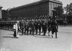 King George V (1865 - 1936) inspects cadets at Trinity College in Dublin, during a visit to Ireland, July 1911. (Photo by Topical Press Agency/Hulton Archive/Getty Images)