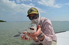 Who is that masked man, and what the heck is he doing wi dat bonefish?