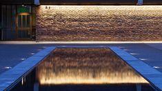 Nulty - Baylis Old School, London - Reflection Pool Brickwork Illumination Listed Buildings Conversion Wall Wash Lighting, Cove Lighting, Facade Lighting, Linear Lighting, Outdoor Lighting, Lighting Design, Lighting Ideas, Pool Landscape Design, Landscape Walls