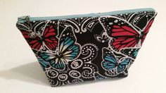 Check out this item in my Etsy shop https://www.etsy.com/listing/287911753/butterfly-makeupzipper-pouch