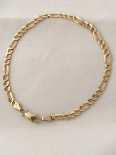 A personal favorite from my Etsy shop https://www.etsy.com/listing/562897841/14k-gold-9-inches-figaro-chain-link