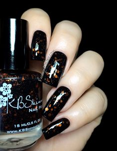Jack is a black jelly with orange hex glitters, a scattering or orange micro slices and black hexes and shreds. It's a 3 coater worn alone but I decided to layer it over black in my swatch to make the glitter pop. Fashion Polish: KBShimmer Fall In Love collection swatches and review!