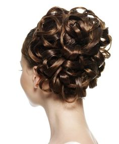 A medium brown straight curly updo wedding bridal hairstyle