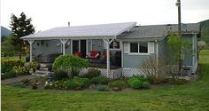 Mobile and Manufactured Home Living . love the porch roof.