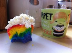 Rainbow cupcakes with pixiedusted buttercream. Nice strata!