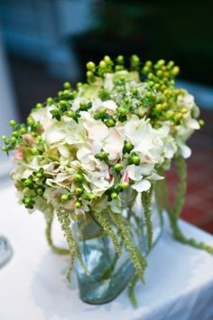 Kiwi Fleur in Savannah, GA. Slightly larger bouquets with white hydrangeas, spray red roses, and green berries for centerpieces.