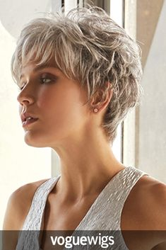 The Rina Synthetic Wig from the Rene of Paris Hi Fashion line is a romantic looking pixie cut. The feathery layers and soft, wispy fringe make this style perfect.