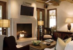 Old World Stoneworks contemporary Manhattan cast stone fireplace mantel with TV mounted above. Modern Fireplace Mantels, Stone Fireplace Surround, Stone Fireplace Mantel, Fireplaces, Family Room, Living Spaces, Manhattan, New Homes, Contemporary
