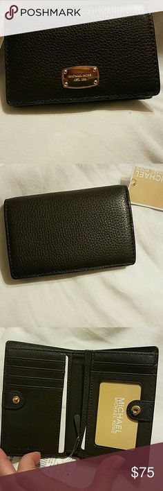 NWT MICHEAL KORS WALLET Micheal kors jet set medium slim leather wallet in the color coffee.  Never used and in perfect condition. 5 card slots and an id slot. MICHAEL Michael Kors Bags Wallets