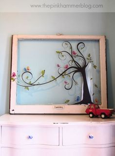Old window with wall decal!    Great use for an old window. Cut decal into sections for a sectioned window, even better than this!