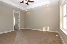 Bedroom with #Shaw NY1 #BeachPebble carpet. #WorldlyGrey wall color.