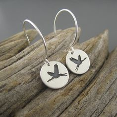These handcrafted sterling silver earrings are inspired by the elegance of the Sandhill Crane in flight. Their annual winter migration always brings a sense of nostalgia while watching their flight south and we wait in great anticipation to see them fill the skies in the spring. Product features:   -Eco-friendly recycled sterling silver.  -Size = 1/2 (1.2cm) in diameter not including sterling silver ear wires.  -Handcrafted in Marquette, Michigan.  The handcrafted story:  Our passion is…