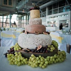Cheese tower instead of cake.  Fruit and cheese dessert? I kinda like this idea... Hope the guests aren't lactose intolerant!
