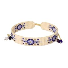 A light, creamy dessert in a braclet. Blueberries delight against creamy white, appearing to expand in cheerful greeting.